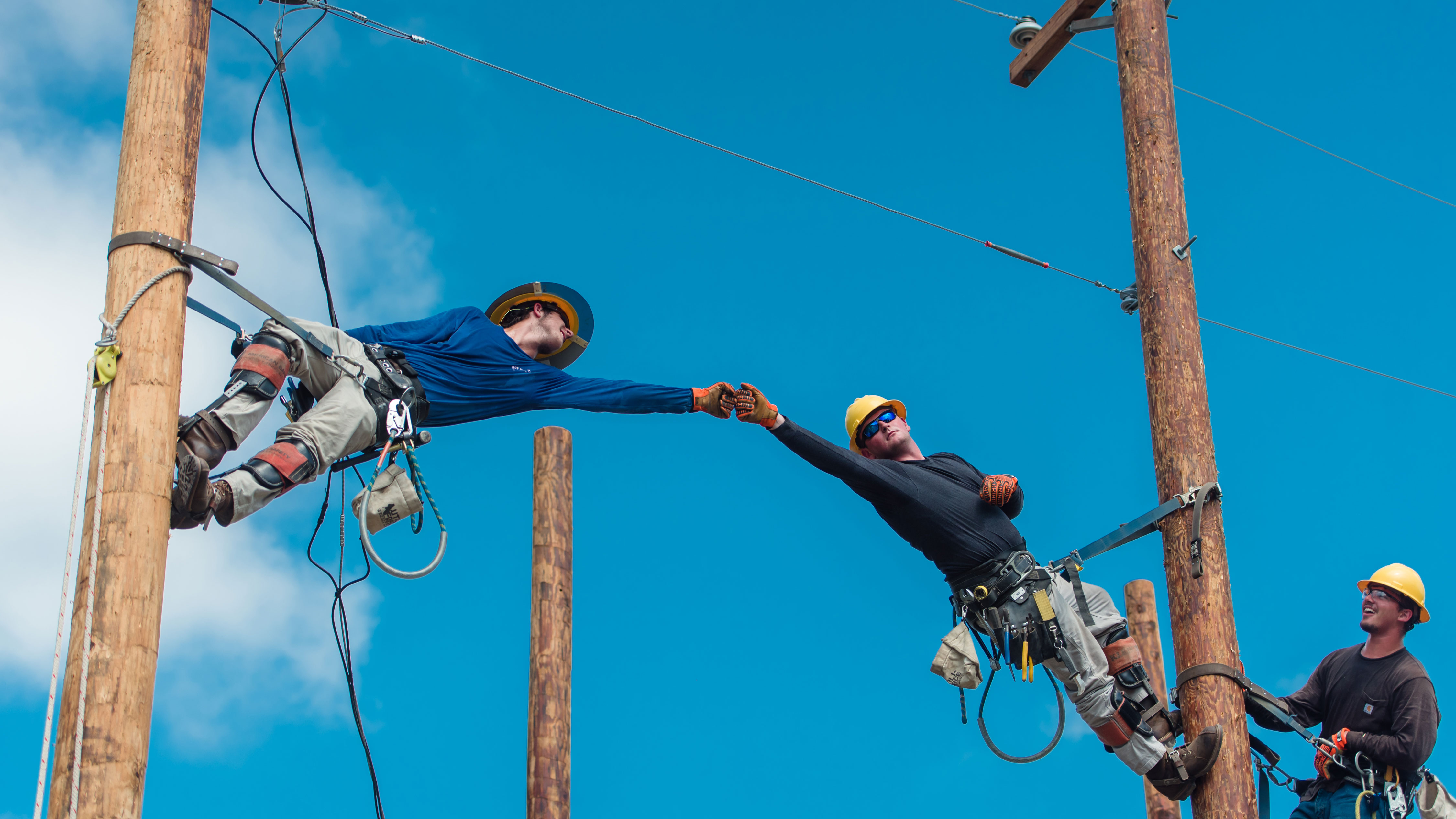 CFCC lineworkers fist bump
